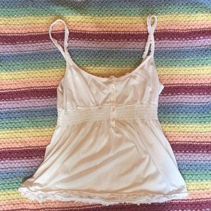 White sleeveless loose top. Size 15/17